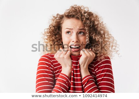 Scary blonde curly woman in casual clothes holding sweater Stock photo © deandrobot