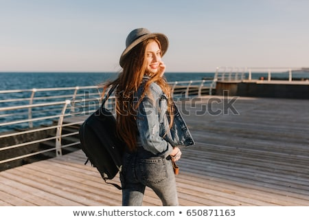 Mutlu kadın bakıyor omuz gülen aşağı Stok fotoğraf © Giulio_Fornasar