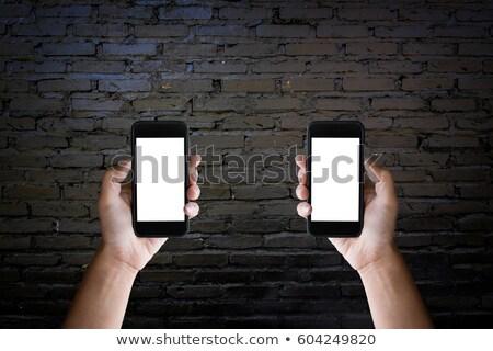 Stock fotó: Kettő · kezek · tart · képernyő · okostelefon · öreg