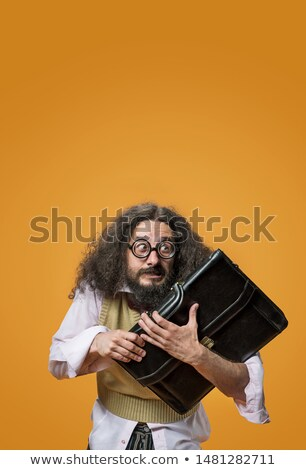 Stock photo: Portrait of a freaky professor holding a briefcase