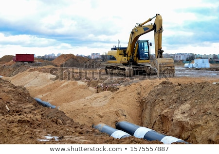 Bulldozer working on sewer construction Stock photo © Kzenon
