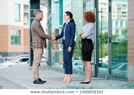 2 実業 会議 外国の パートナー 入り口 ストックフォト © pressmaster