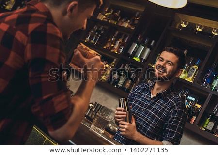 Garçom falante cliente bar contrariar boate Foto stock © wavebreak_media