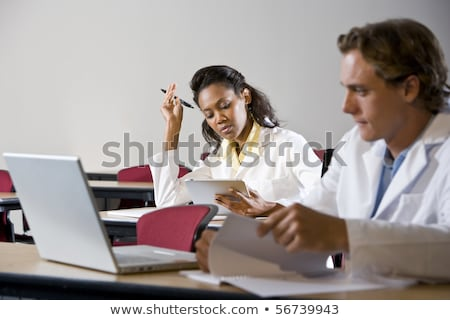 Stock photo: Two medical students studying in classroom