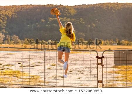 Aussie woman standing on a rural farm gate Stock photo © lovleah