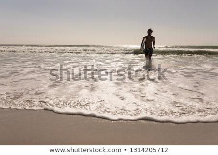 Fronte view a torso nudo giovani maschio surfer Foto d'archivio © wavebreak_media