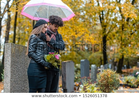 Couple in grief on a cemetery in fall Stock photo © Kzenon