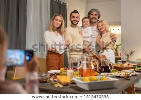 Derűs szeretetteljes család néz okostelefon kamera Stock fotó © pressmaster
