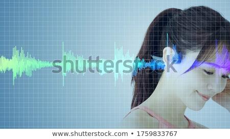 Donna ascoltare musica wireless speaker donna sorridente computer Foto d'archivio © AndreyPopov