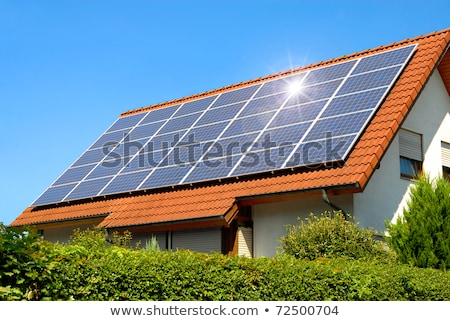 Houses with solar cell on the roof Stock photo © bluering
