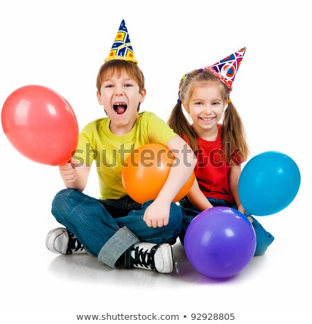 Boy on birthday party 1 year on the background of red balloons Stock photo © ElenaBatkova