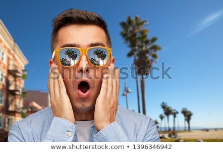 Surpreendido homem óculos de sol Veneza praia verão Foto stock © dolgachov