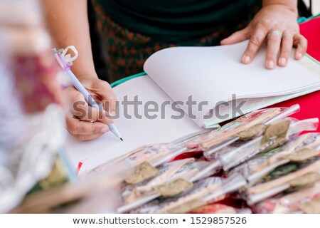 Wedding album, blank page, guest list, to do list. Notebook and asters on canvas background. Stock photo © ruslanshramko