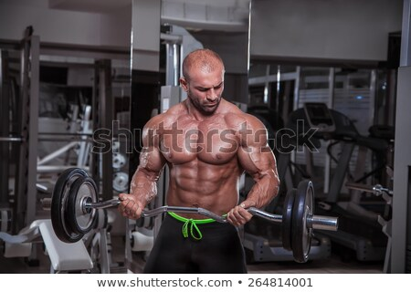 Men In The Gym Performing Biceps Curls With A Barbell Stock photo © Jasminko