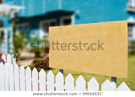 blank wooden board for rent or sell estate stock photo © ansonstock