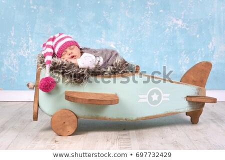 toddler girl sleeping on plane Stock photo © phbcz