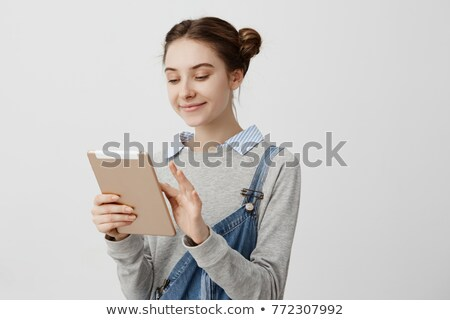 Smiling Woman Watching A Touchpad Screen Stock photo © Amosnet