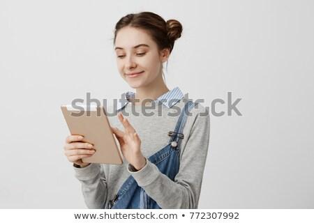 улыбающаяся женщина смотрят touchpad экране счастливым улыбаясь Сток-фото © Amosnet