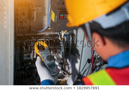 Stock photo: Electricians installing electrical cabling