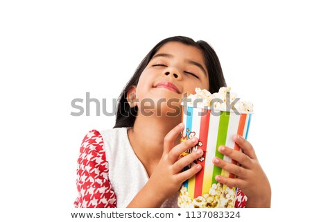 Happy girl eating popcorn - closeup Stock photo © lightkeeper