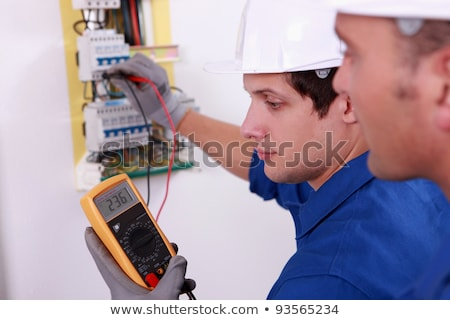 two technical engineers checking electrical equipment stock photo © photography33
