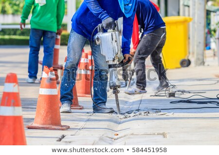 A man drilling the floor. Stock photo © photography33