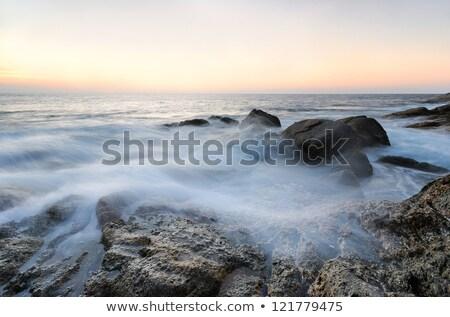 Sea waves lash line impact rock Stock photo © chatchai