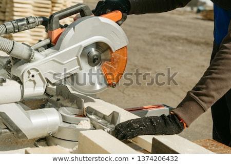 Stock photo: Man and woman using circular saw