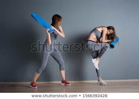Womans legs against white wall Stock photo © studiofi