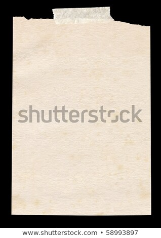 Isolated old piece of paper stuck to a black background. Stock photo © latent