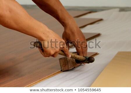 Man installing hard-wood flooring Stock photo © photography33
