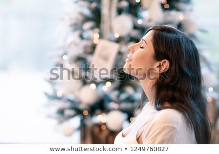 nice brunette lady relaxing with closed eyes stock photo © konradbak