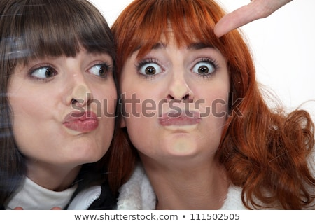 Friends making a silly face against a windowpane Stock photo © photography33