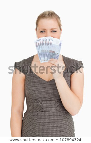 Woman hiding her mouse with euro banknotes against white background Stock photo © wavebreak_media