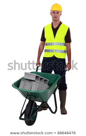 Man pushing waste material in wheelbarrow Stock photo © photography33