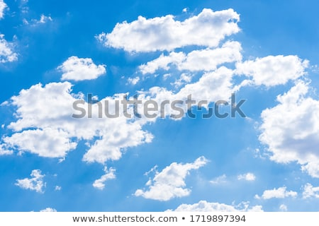 Fluffy clouds in sky. Stock photo © iofoto