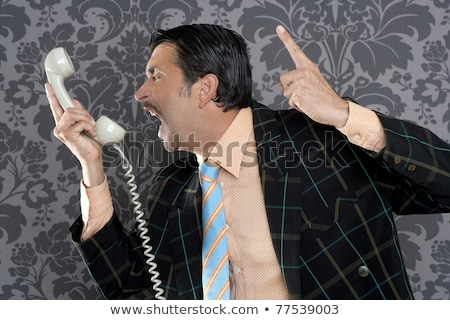 Stock photo: Man Screaming Into the Telephone