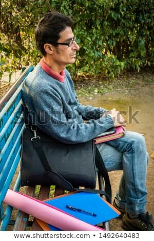 Işadamı notlar kalem oturma bank park Stok fotoğraf © jakubzak