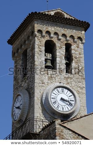 Bell Tower and Clock of Notre Dame clock Church in Cannes, Franc Stock photo © anshar