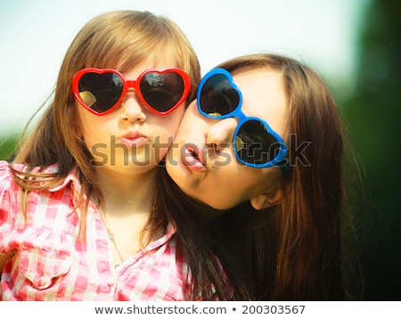 Stock photo: Mother And Daughter Making Silly Faces
