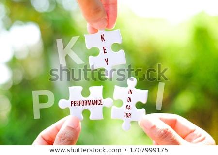 Azul piezas del rompecabezas negocios clave rendimiento escrito Foto stock © tashatuvango