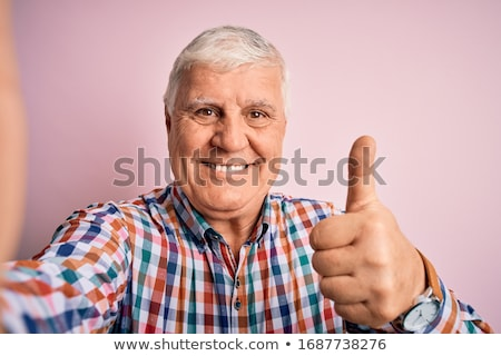 old casual man making the ok thumbs up hand sign Stock photo © feedough