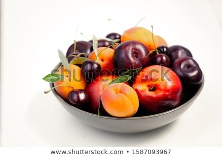 Fresh juicy peaches over green leaves isolated on white Stock photo © tetkoren