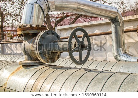 old pipelines with valve for a rotten water heating and controli Stock photo © meinzahn