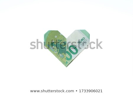 Euro banknotes with heart from hundred bill Stock photo © ifeelstock