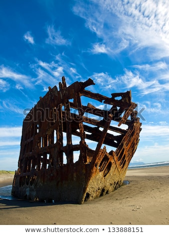 rusty wreckage of a ship on a beach on the oregon coast usa stock photo © frankljr