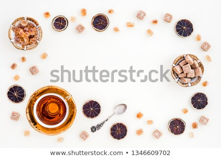 Brown, unrefined sugar and a silver spoon in it Stock photo © photocreo