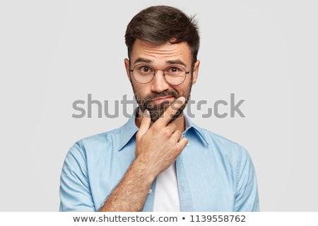 Twijfels jonge man twijfelen naar camera Stockfoto © stokkete