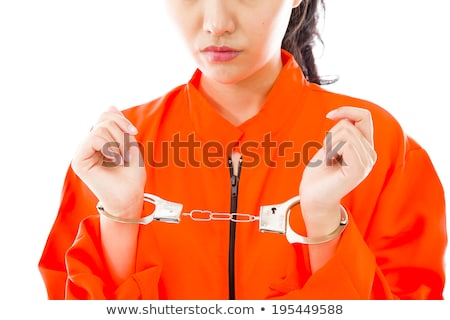 Megbilincselve ázsiai fiatal nő egyenruha nő narancs Stock fotó © bmonteny
