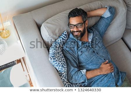 Indian man relaxed and thinking Stock photo © ziprashantzi